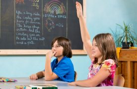 Fifth Grade Student Raising Hand