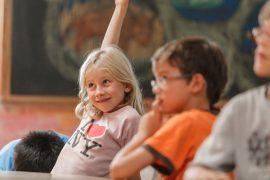 Child Raising Hand in Second Grade