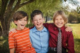 Three Fourth Graders Smiling